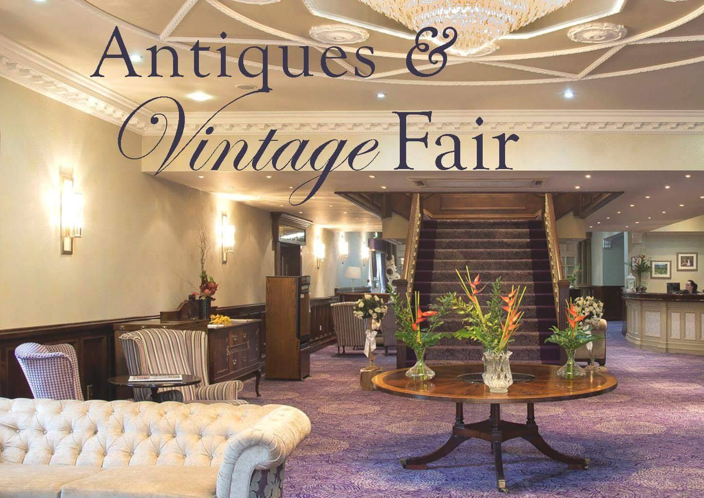 """Image shows a warm and plush hotel interior, namely that of the Woodford Dolmen Hotel in Carlow, Ireland. Superimposed on the image is the text """"Antiques & Vintage Fair"""" in reference to the events held there by vintageireland.eu"""